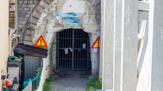 Dark tunnel to the nudist beach of Guvano is closed, Cinque Terre, Italy