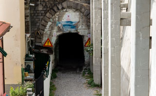 Dark tunnel to the nudist beach of Guvano, Corniglia, Cinque Terre, Italy