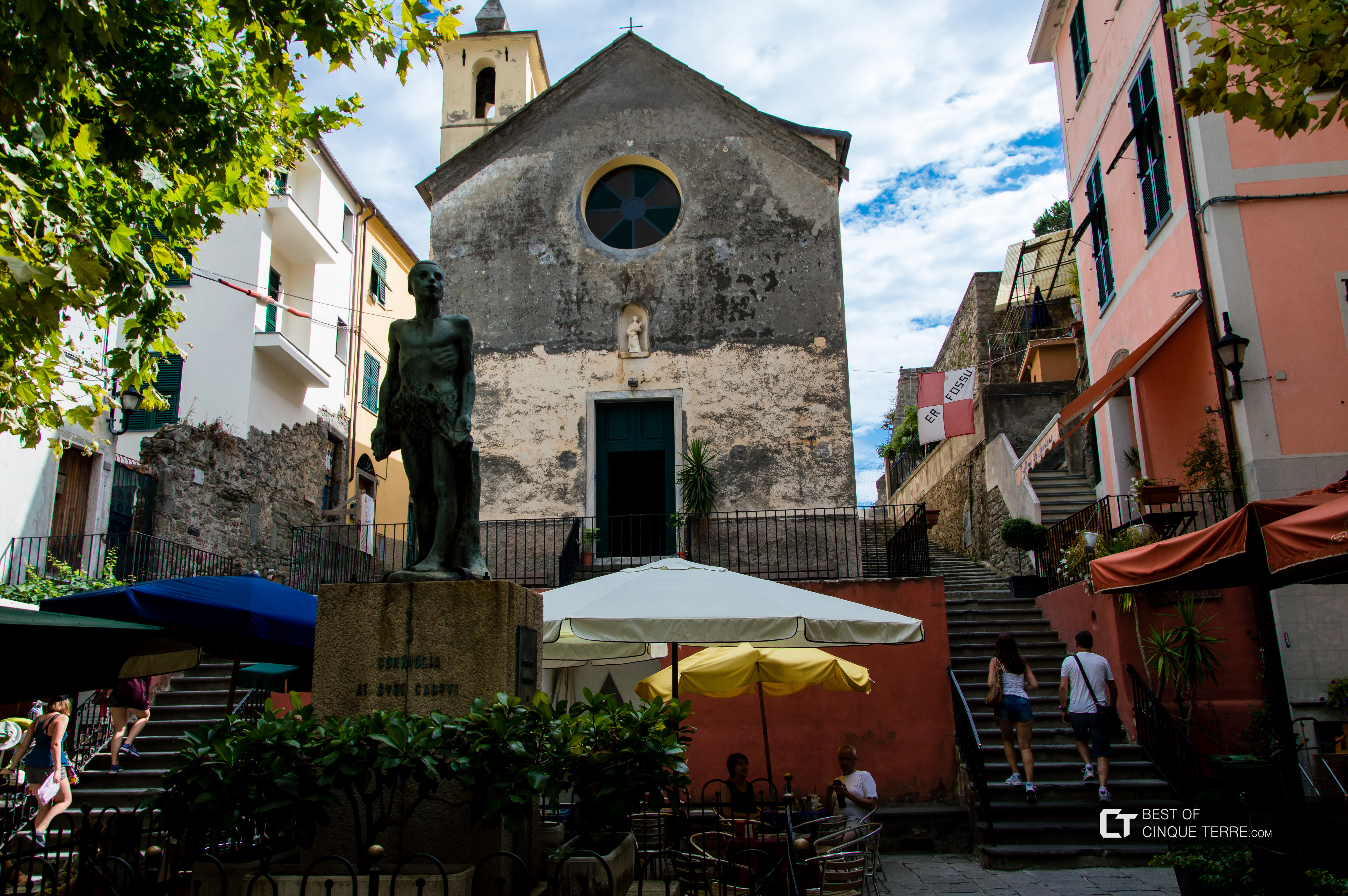 The main square Largo Taragio, chapel and monument to the fallen, Corniglia, Cinque Terre, Italy