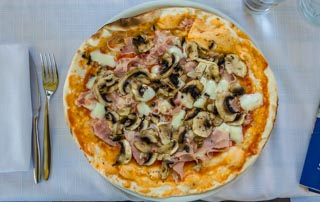 Pizza with mushrooms and prosciutto cotto (ham), Local food, Cinque Terre, Italy