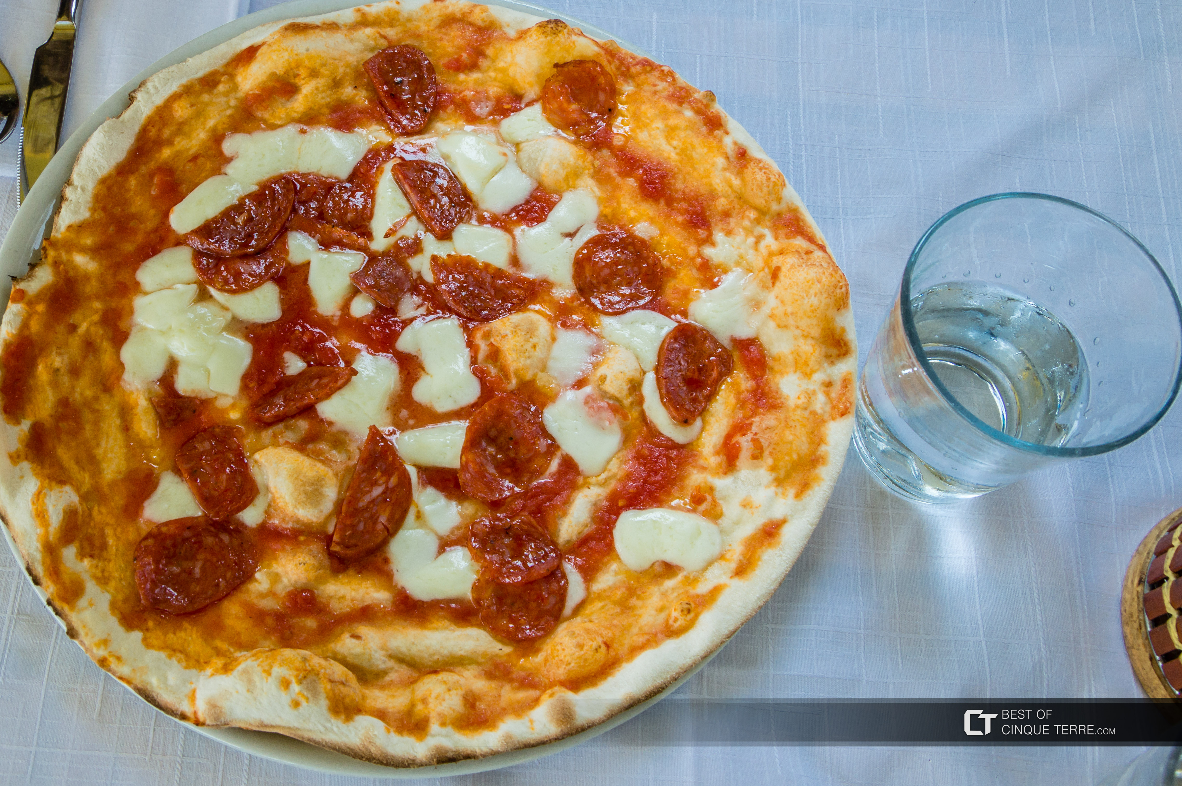 Pizza with spicy salami, Local food, Cinque Terre, Italy