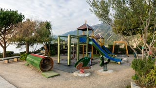 Children's playground on the hill near the waterfront, Manarola, Cinque Terre, Italy