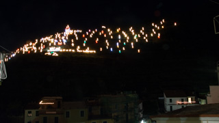 Christmas nativity scene (Presepe), seen from the main square of the village, Manarola, Cinque Terre, Italy