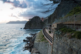 View of the station and the village behind the rock from the Path of Love, Manarola, Cinque Terre, Italy