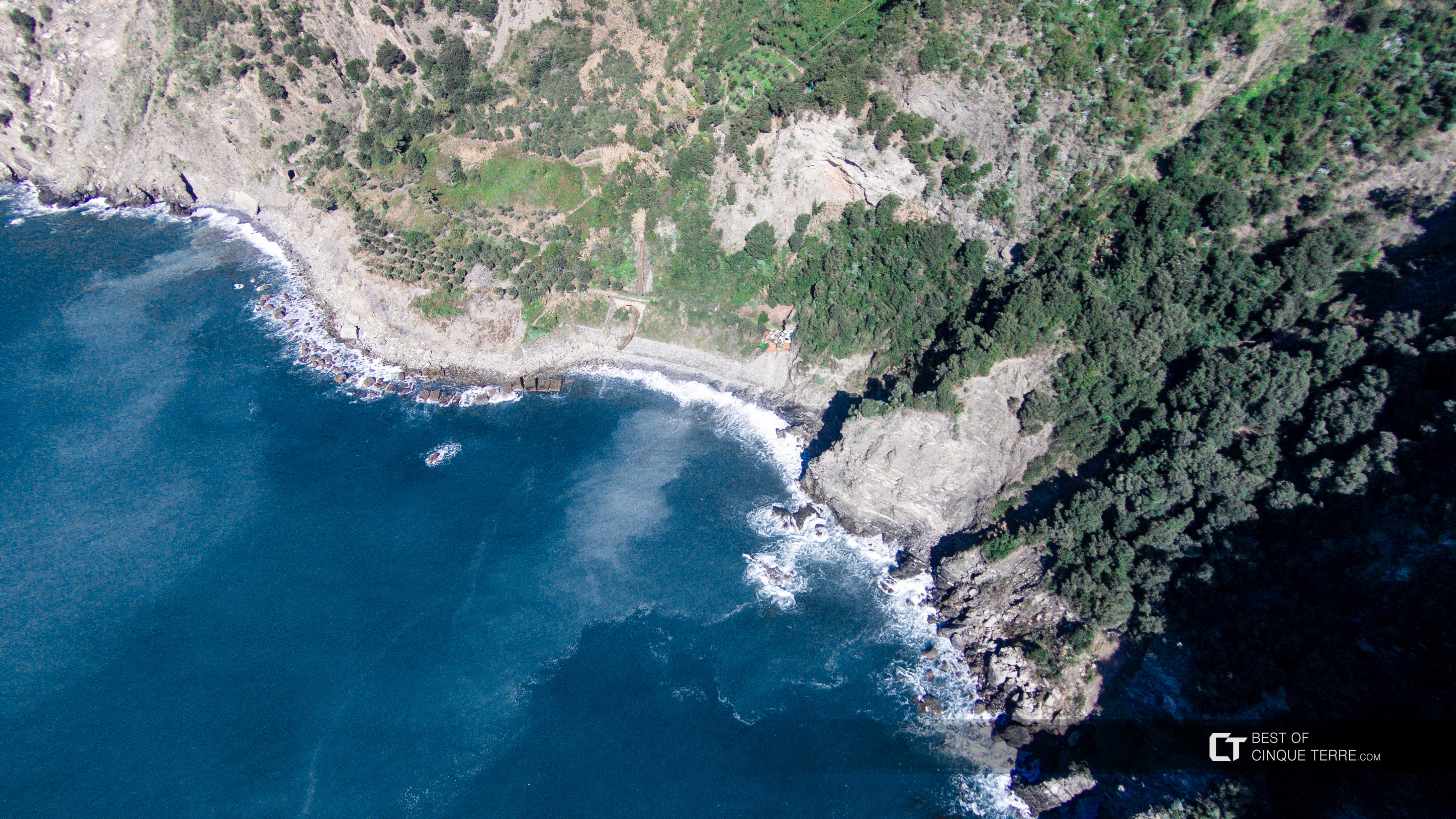 Aerial view of the nudist beach of Guvano in winter, Corniglia, Cinque Terre, Italy
