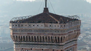 Tourists on Giotto's bell tower - view from the dome of the Cathedral, Florence, Italy